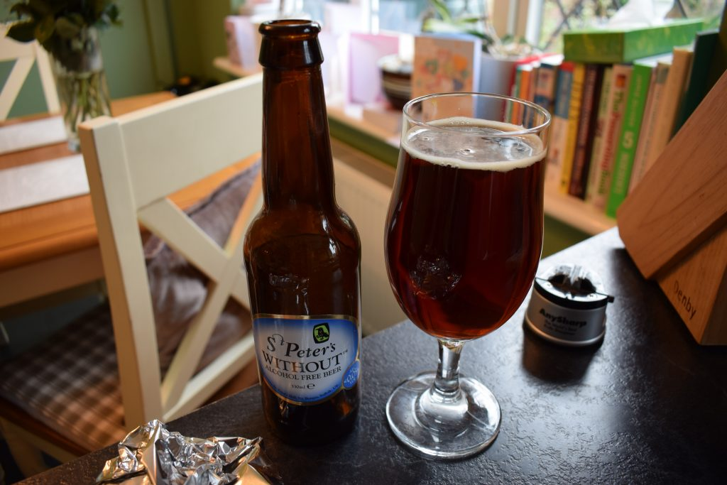 St Peter's Brewery Without Non-Alcoholic beer bottle and glass
