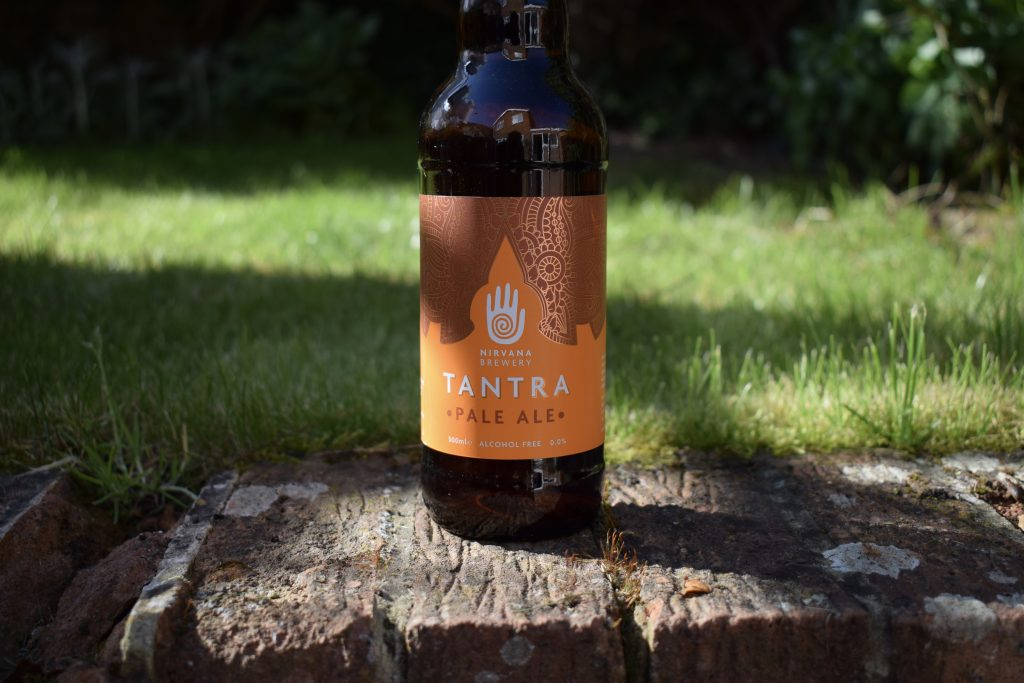 Bottle of Nirvana Tantra pale ale with glass