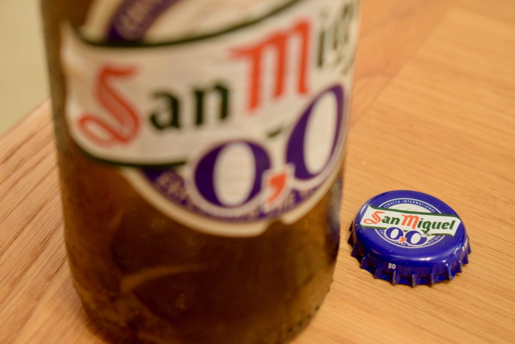 San Miguel 0.0 label and bottle cap