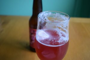 Mikkeller Raspberry Limbo non-alcoholic sour beer - close up of glass and foam