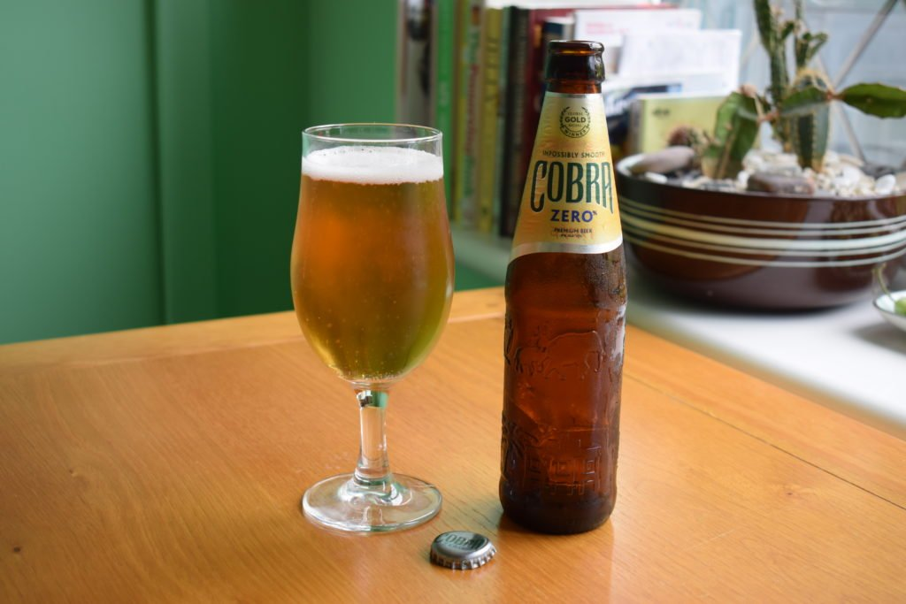 Cobra Zero non-alcoholic lager glass and bottle