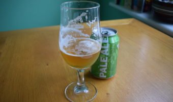 Can of Big Drop Pale Ale behind a glass