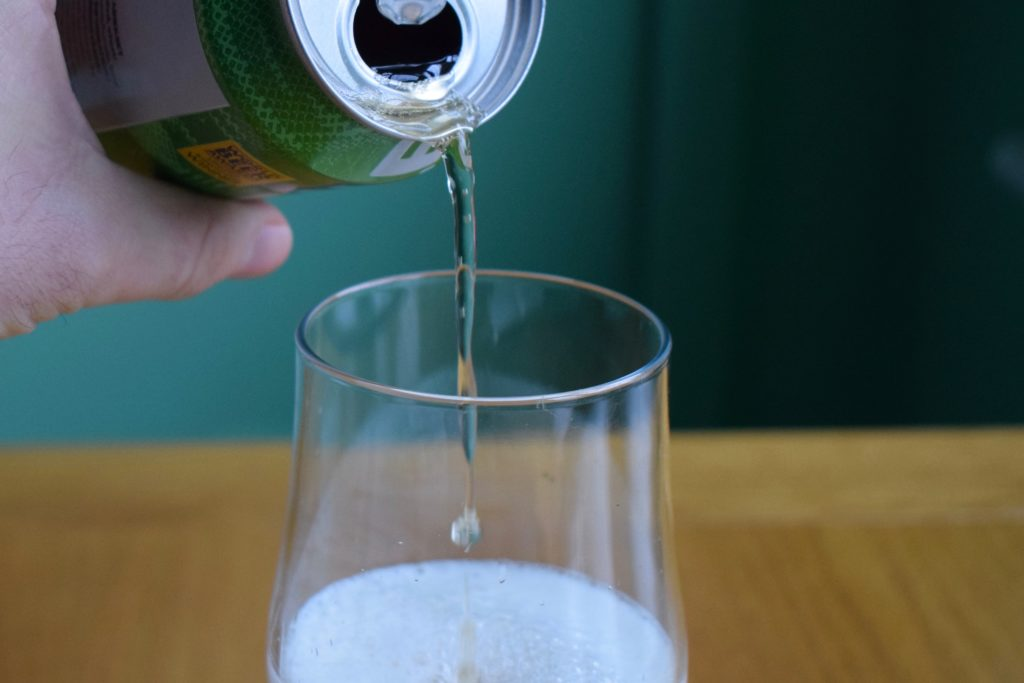 Can of Big Drop Pale Ale being poured into a glass