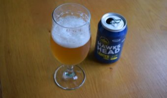 Can and glass of Hawkshead Light Times non-alcoholic pale ale