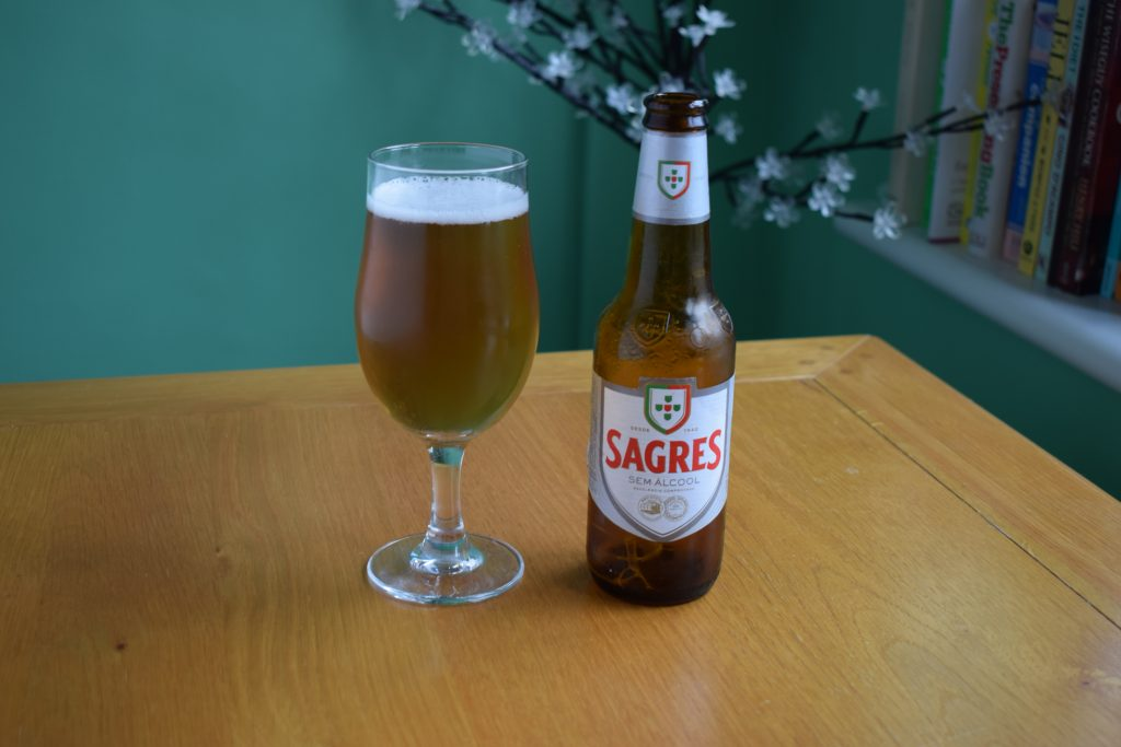 Bottle of Sagres non-alcoholic lager with glass