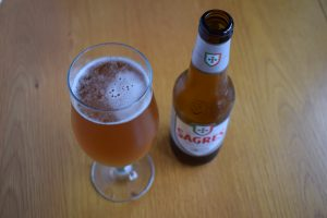 Bottle of Sagres non-alcoholic lager with glass from above
