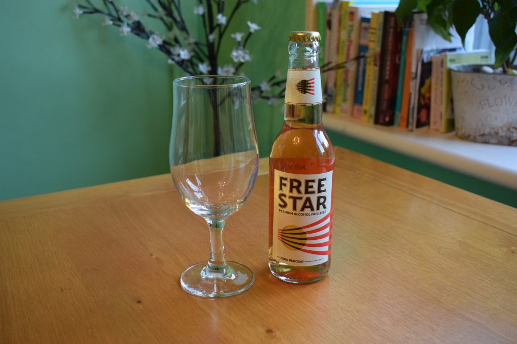 Bottle of Freestar beer with empty glass