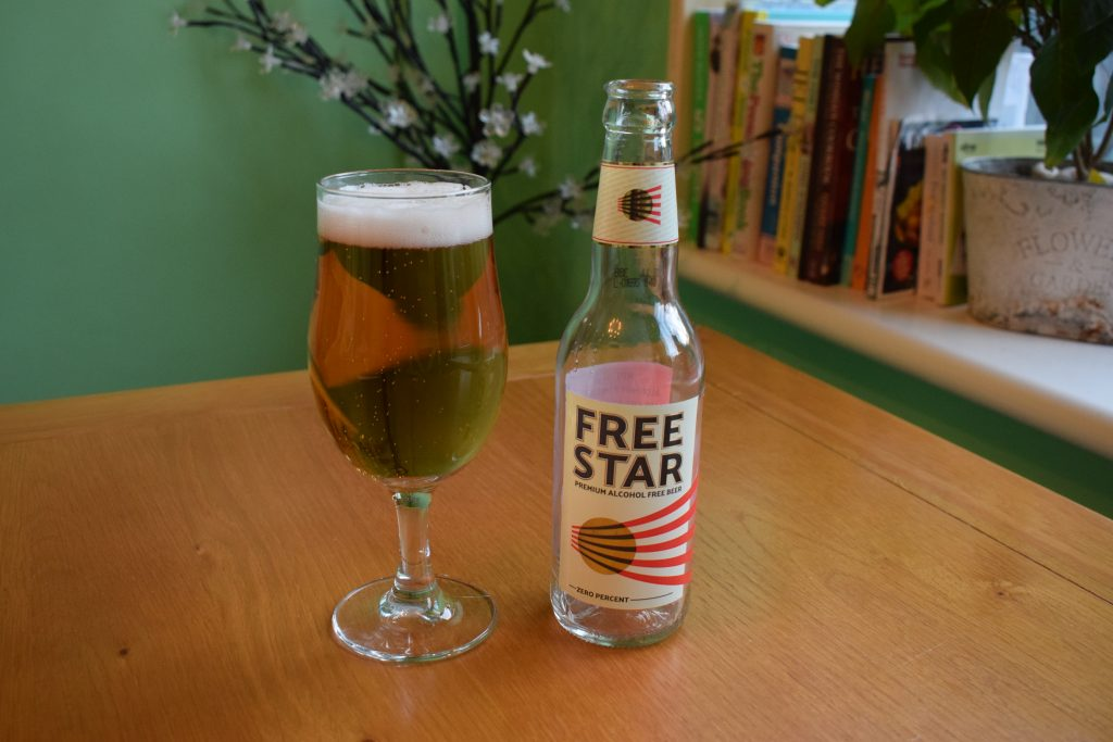 Empty bottle of Freestar beer with full glass