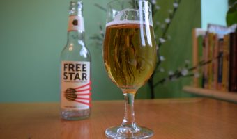 Freestar beer bottle with full glass in foreground