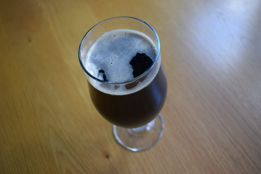 Glass of Brewdog Wake Up Call Alcohol-Free Stout from above