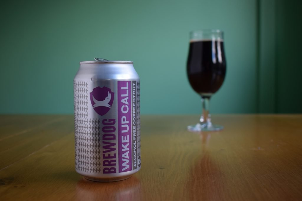 Can of Brewdog Wake Up Call Alcohol-Free Stout with full glass in background