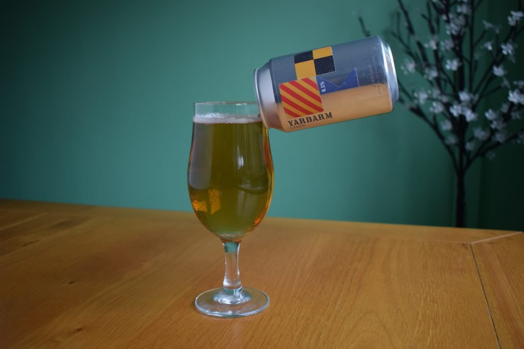 Close up of can of Jump Ship Yardarm non-alcoholic lager with glass