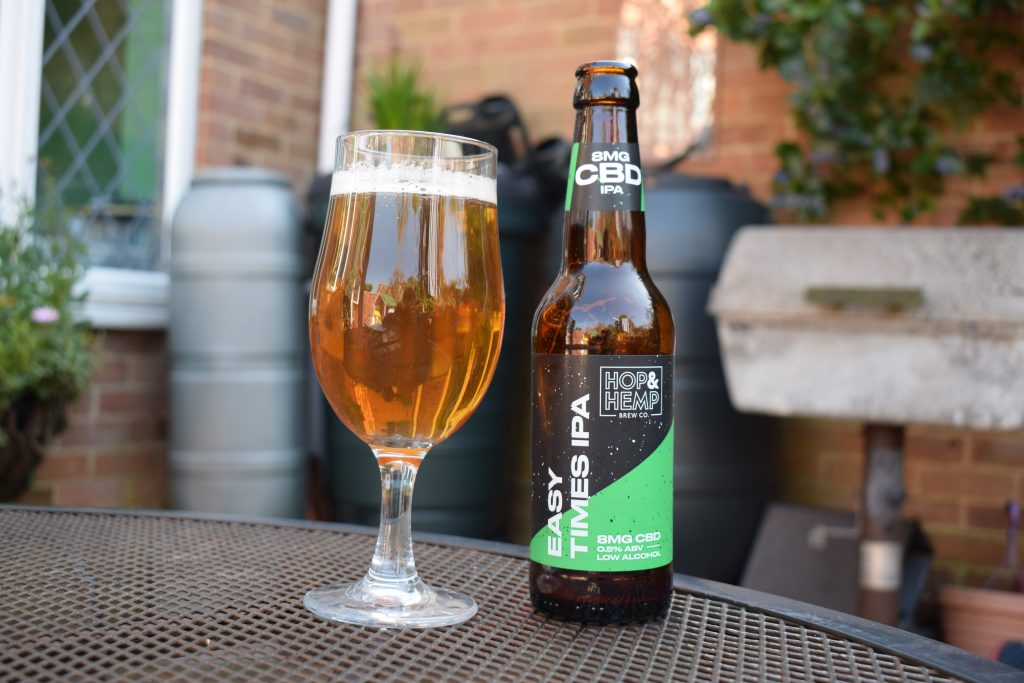 Easy Times IPA non-alcoholic CBD beer bottle and glass