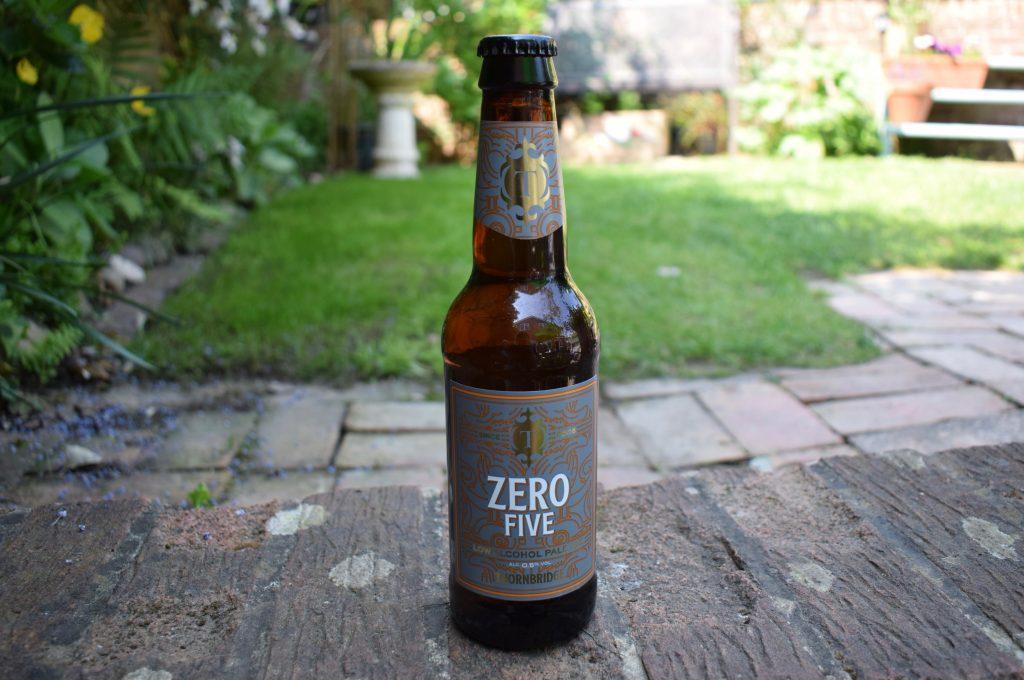 Bottle and glass of Thornbridge Zero Five non-alcoholic beer bottle