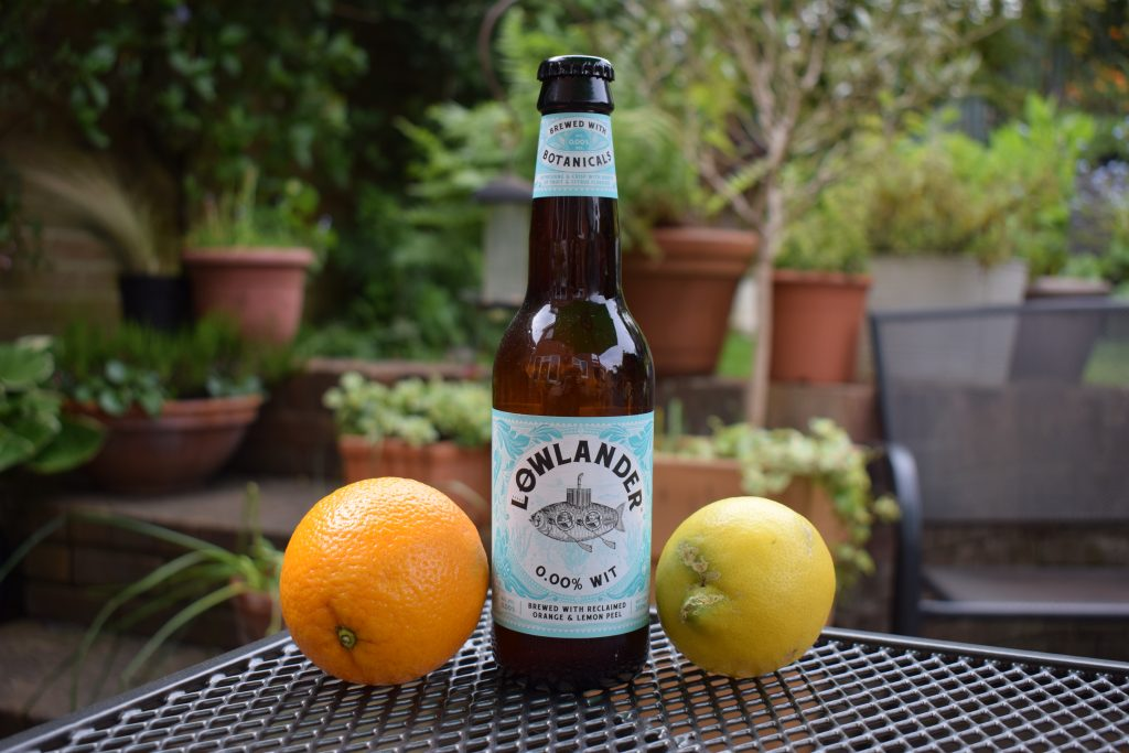 Lowlander Wit non-alcoholic beer bottle with lemon and orange