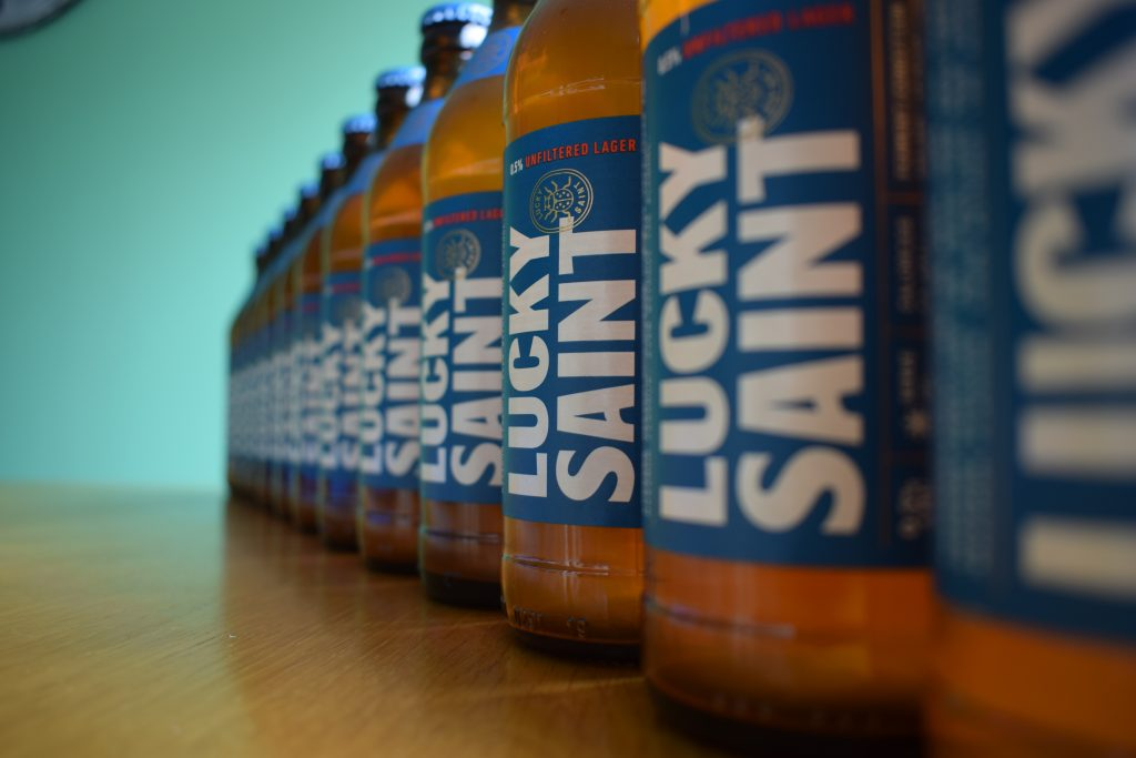 A row of Lucky Saint non-alcoholic lagers