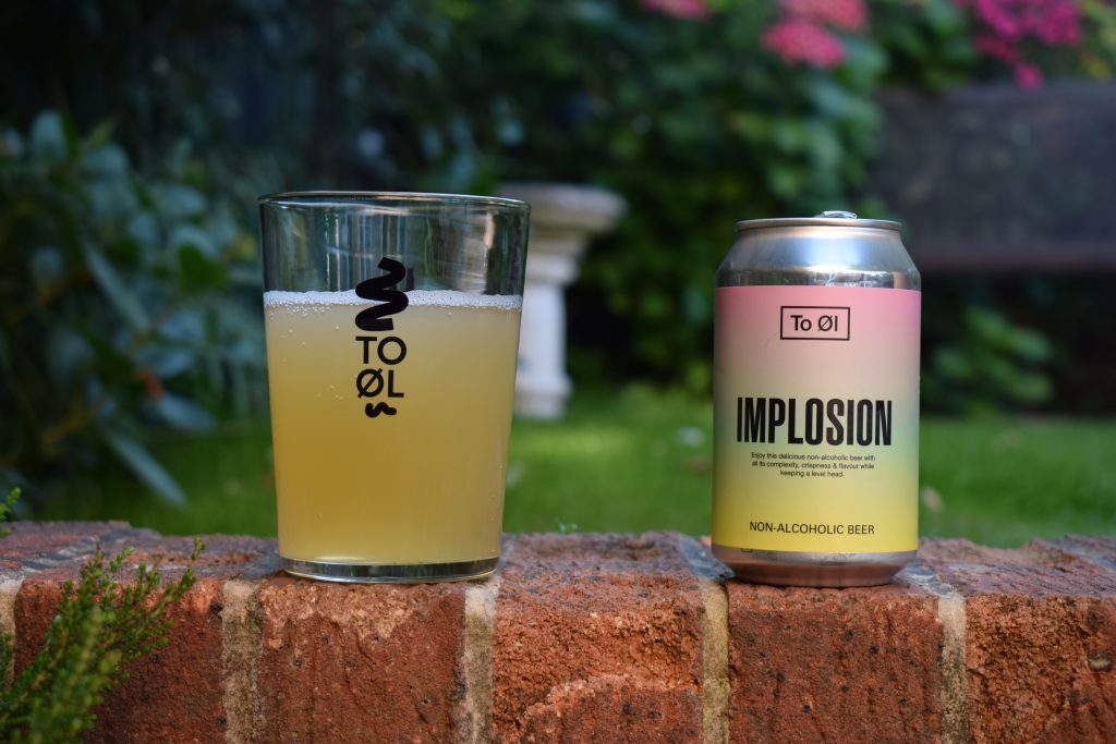 To Ol Implosion non-alcoholic beer - glass and can