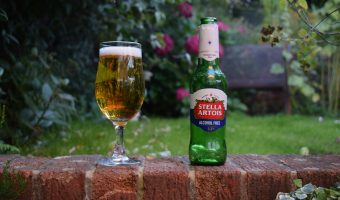 Bottle of Stella Artois Alcohol-Free lager with glass