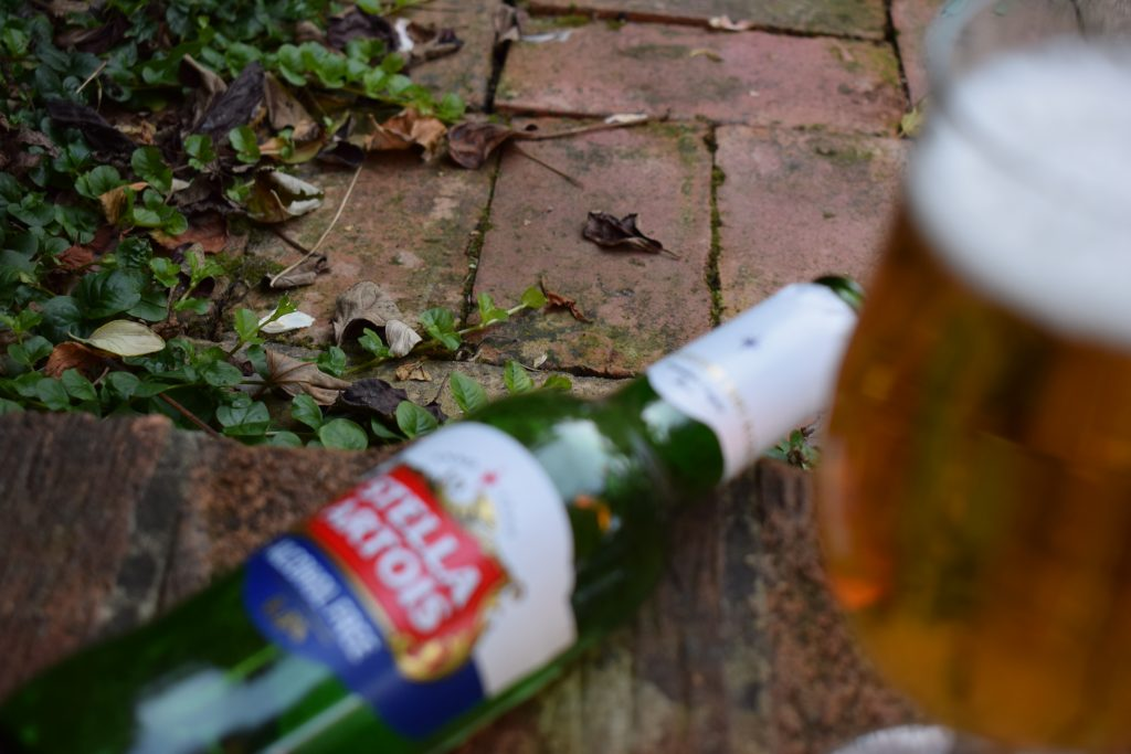 Bottle of Stella Artois Alcohol-Free lager and glass out of focus