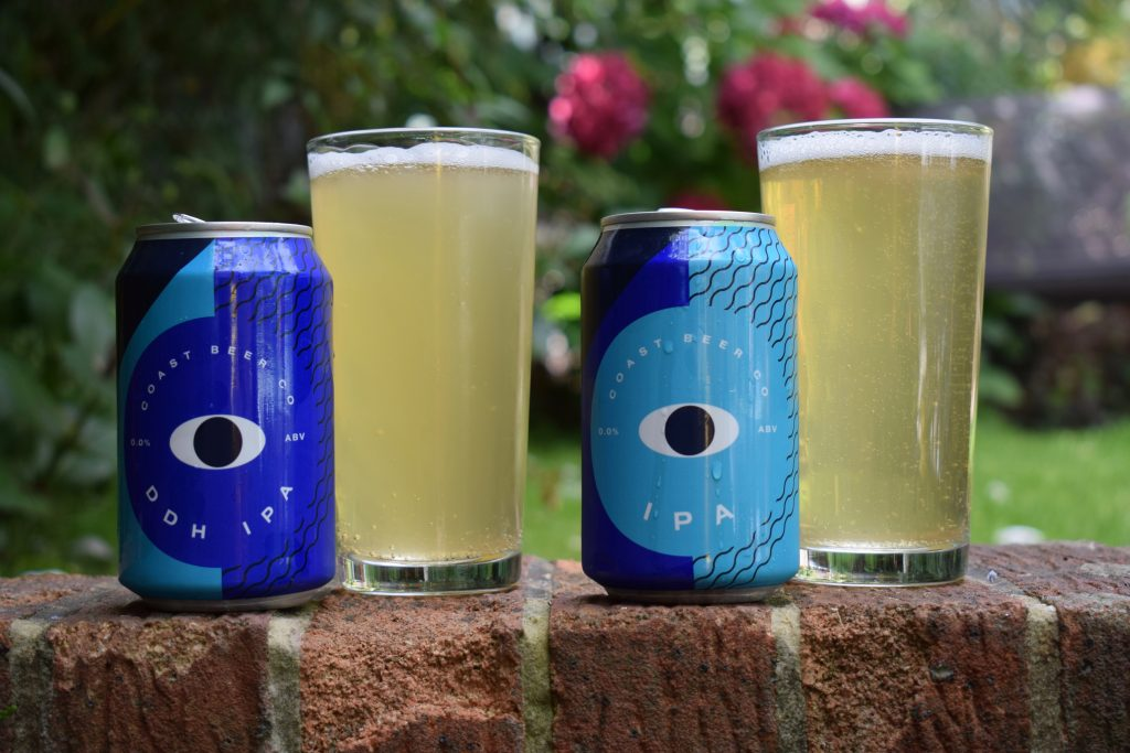 Cans and glasses of Coast Beer Co IPA and DDh IPA