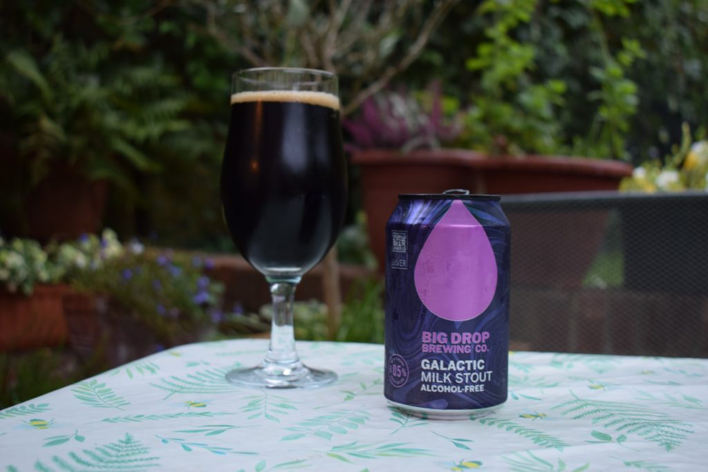Can of Big Drop Galactic milk stout with glass