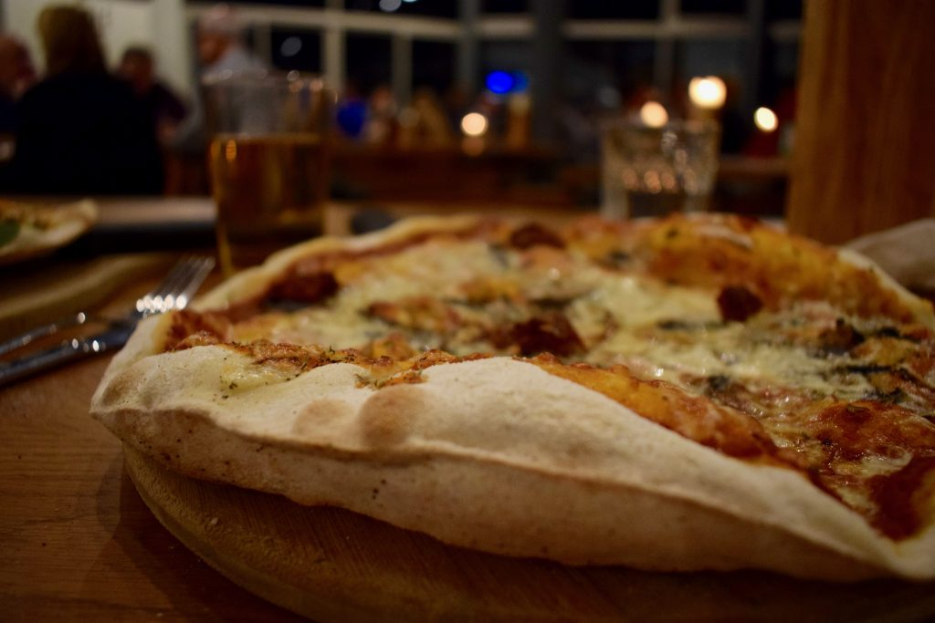 Close up of pizza in a dark bar