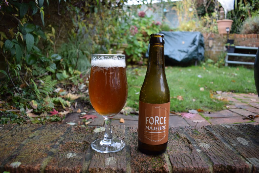 Force Majeure Tripel - glass and bottle