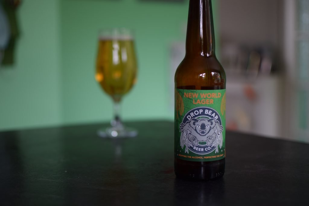 Drop Bear New World Lager glass and bottle in foreground