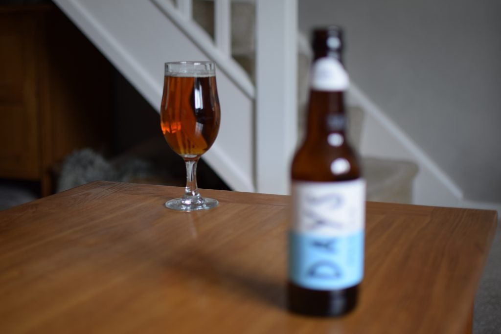 Days Brewing Pale Ale glass with bottle in foreground