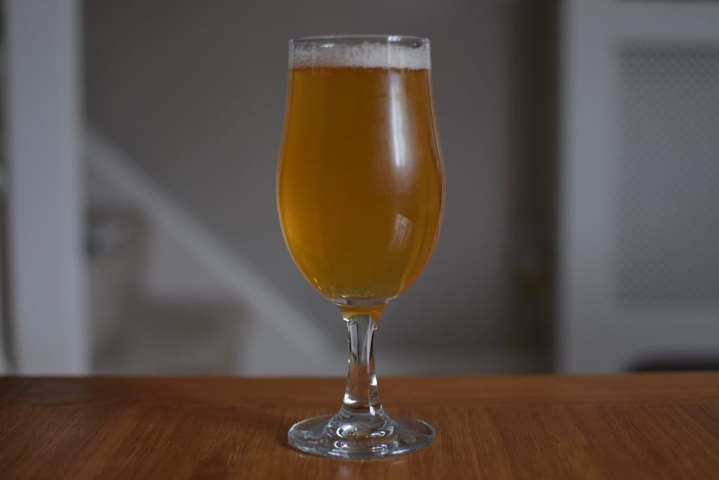 Glass of Athletic Brewing Upside Dawn