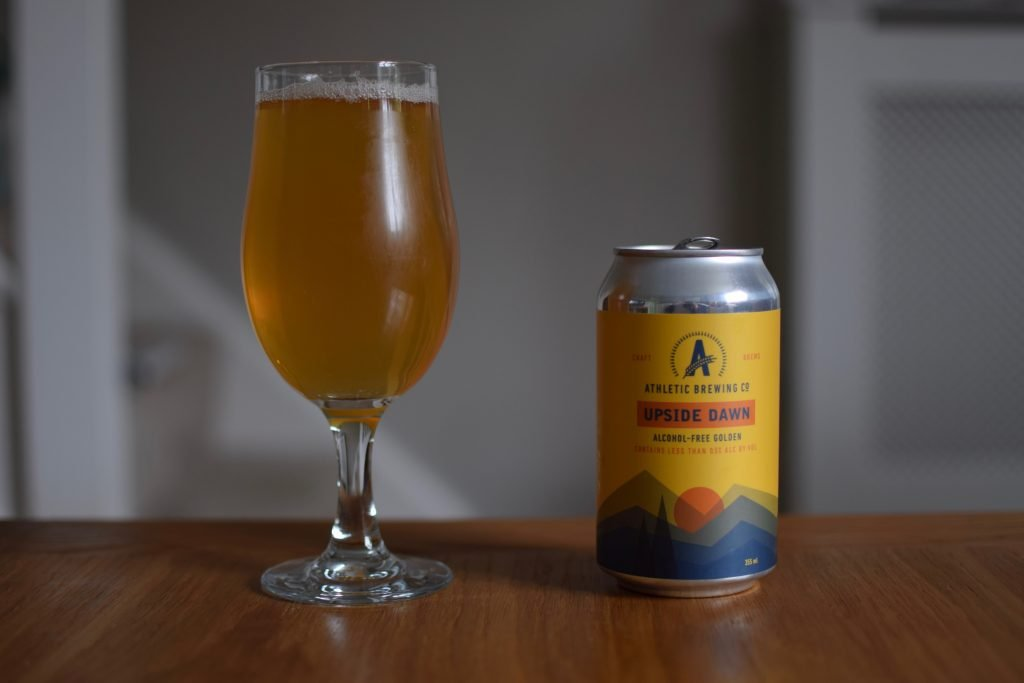 Can and glass of Athletic Brewing Upside Dawn