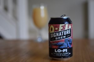 Signature Brew Lo-Fi non-alcoholic pale ale - can with glass in background
