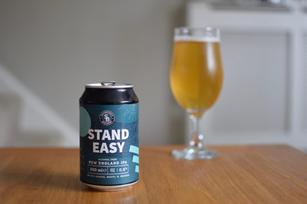 Can and glass of Sambrook's Stand Easy non-alcoholic beer