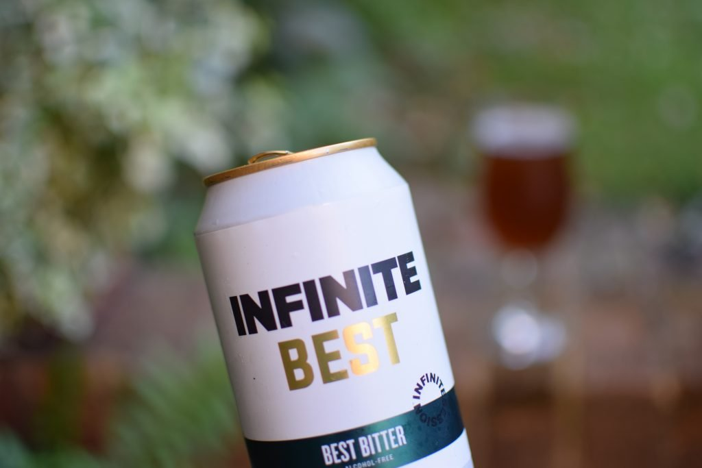 Infinite Session Best Bitter - can with glass in background