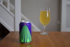Can of Omnipollo Konx non-alcoholic pale ale with glass in background