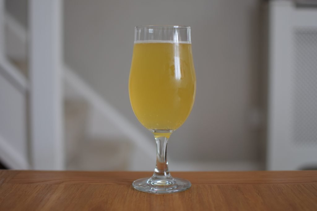 Glass of Omnipollo Konx non-alcoholic pale ale