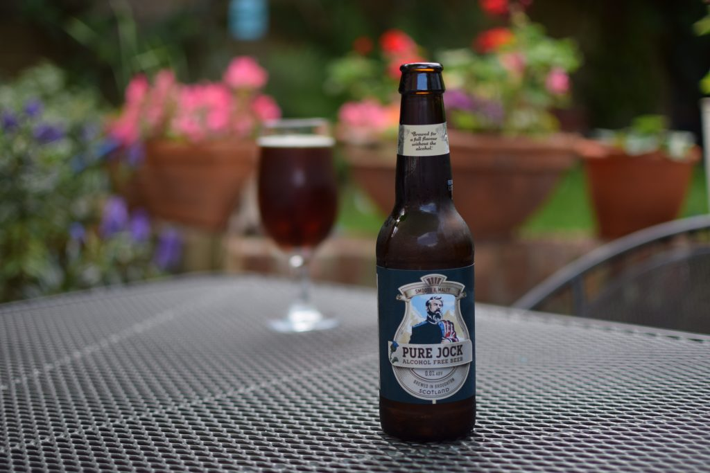 Broughton Pure Jock scotch ale - bottle and glass